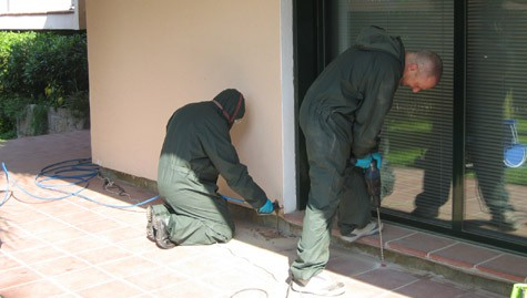 Technician treating termite infestation